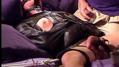 Leather straitjacketed stud electrostim.
