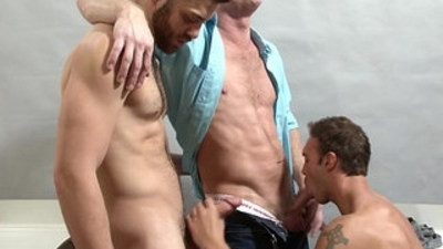 Well built tops fuck bottom in threesome